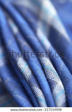 Close up of blue checked material in a row  - stock photo