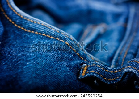 Close up of blue crumpled jeans - shallow depth of field - stock photo