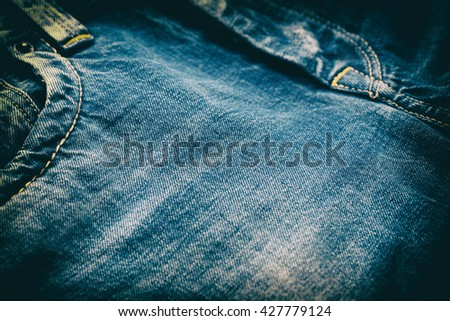 Close-up of blue denim jeans pattern, vintage look. Shallow depth of field. - stock photo