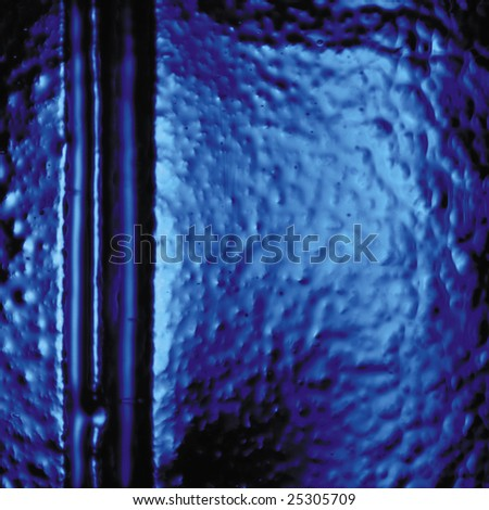 Close-up of blue textured glass bottle. - stock photo
