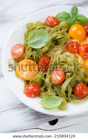 Close-up of boiled tagliatelle with fried tomatoes, studio shot