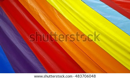 close up of bold rainbow stripes of sailboat spinnaker