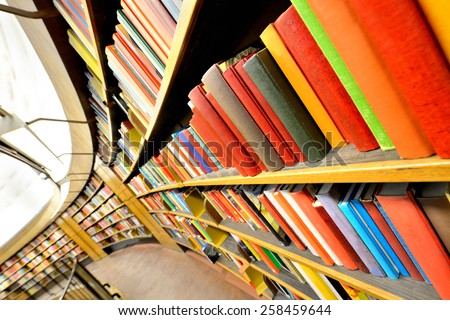 Close up of bookshelves. Interior blurred. - stock photo
