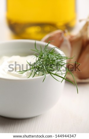 Close-up of bowl with yogurt and dill.
