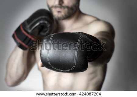 close-up of boxer glove / punch of a boxer - stock photo