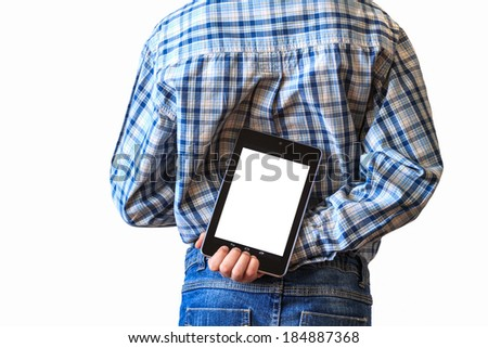 close up of boy holding tablet computer behind his back as gift - stock photo