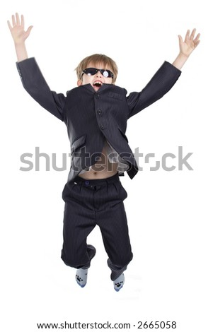 Close-up of boy in business suit. Shot in studio. Isolated with clipping path.