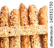 Close up of bread sticks on white background - stock photo