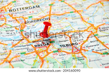Close up of  Breda , Netherlands  map with red pin  - Travel concept - stock photo