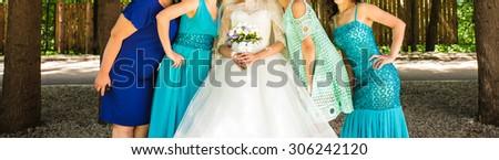 Close up of bride and bridesmaids. Beautiful girls - stock photo