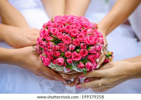 Close up of bride and bridesmaids bouquet - stock photo