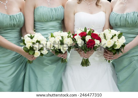 Close Up Of Bride And Bridesmaids Holding Flowers - stock photo