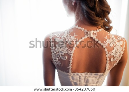 Close up of bride's back - stock photo