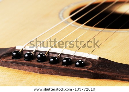 Close up of bridge pin and sound ,acoustic guitar