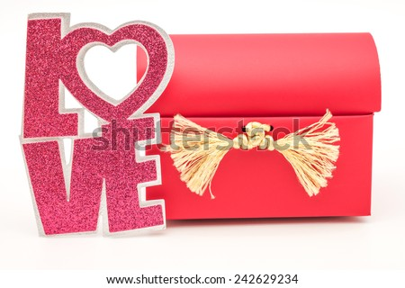 Close up of bright red paper gift box with letter love for valentines or special occasion on white background - stock photo
