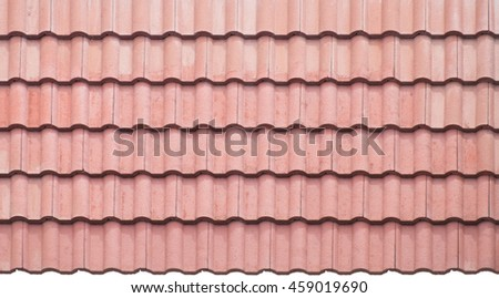 Close up of bright red tile roof surface, abstract background texture