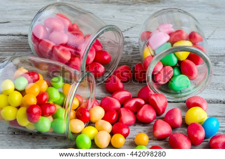 Close-up of bright scattered on table candies - stock photo