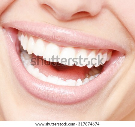 close up of bright smile with healthy teeth - stock photo