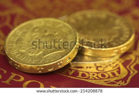 Close up of British Pound coin on passport - stock photo