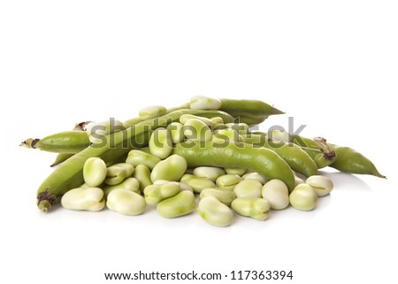 Close-up of broad beans and few pods