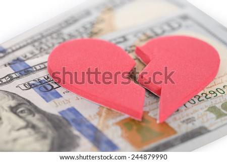 Close-up Of Broken Heartshaped On Us Currency - stock photo