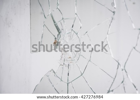 Close-up of broken mirror on wall - stock photo