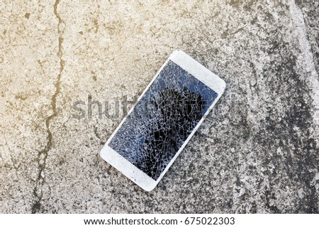 Close up of broken mobile phone drop on cement floor
