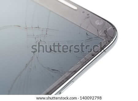 Close up of broken smart phone isolated on white background - stock photo