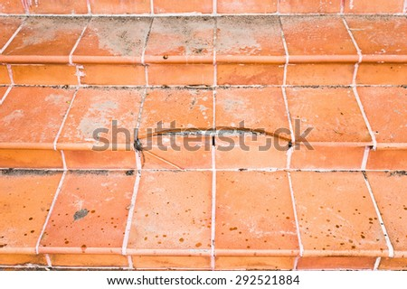Close up of broken terracotta tiled steps, as a background - stock photo