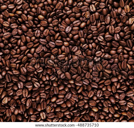 close-up of Brown coffee beans the best for background and texture. pile of coffee beans with copy space for text and Graphic design