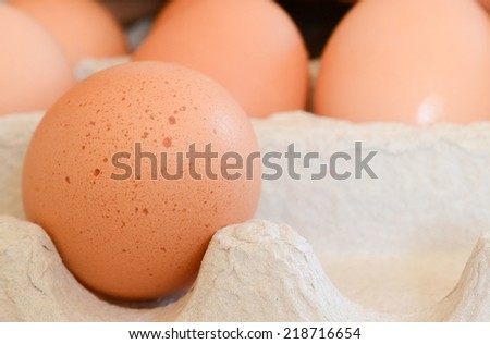 Close up of brown eggs in a carton