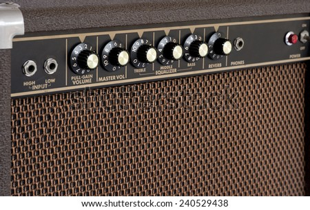 Close up of brown electric guitar amplifier - stock photo