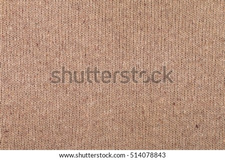 Close-up of  brown knitted wool texture
