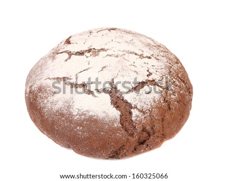 Close up of brown round bread. Isolated on a white background