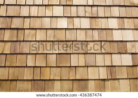Close up of brown wood roof shingles. - stock photo