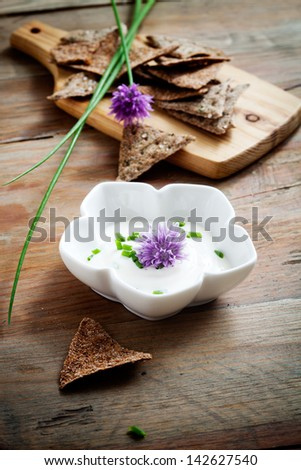 Close up of bunch of chives on table - stock photo