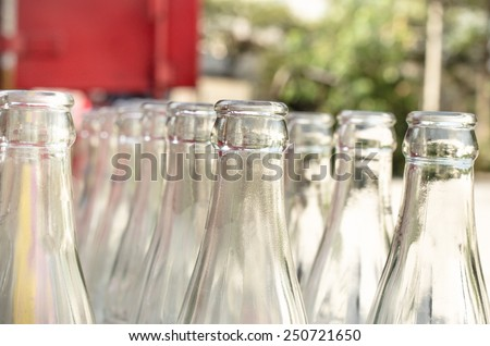 Close up of bunch of used glass bottles. Soft focus. / Bunch of used glass bottles. outdoor view/ Close up of bunch of used glass bottles. Soft focus.(bottles, glass, beverage) - stock photo