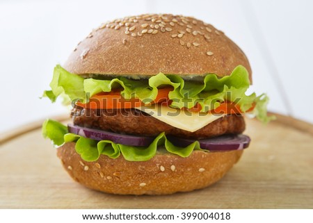 Close Up of Burger on Rustic Wooden Table Surface