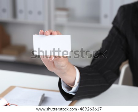 Close-up of business card in women hand.