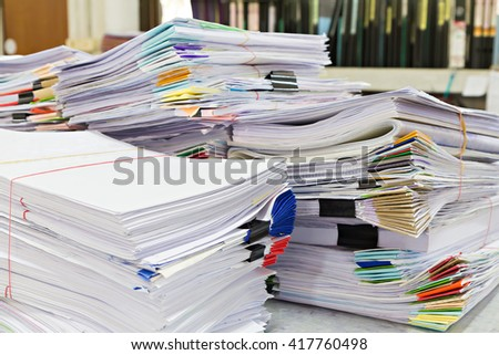 Close up of business documents stack on desk , report papers stack - stock photo