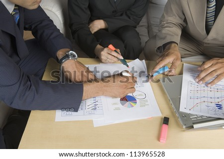 Close-up of business executives on a meeting - stock photo