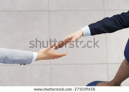 Close up of business handshake between two colleagues - stock photo