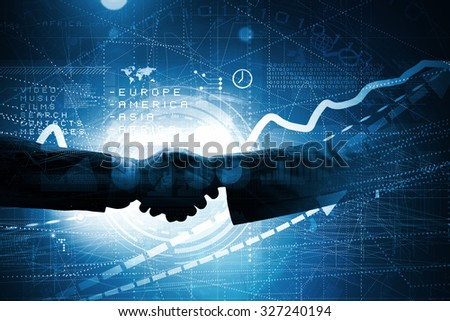 Close up of business handshake on digital background - stock photo