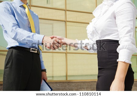 Close-up of business handshake: partners making agreement - stock photo