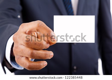 Close-up of business man handing a blank business card over white background - stock photo