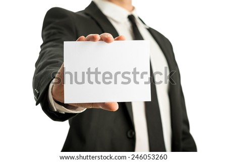 Close up of business man holding white blank card with copyspace ready for your text or letters. Isolated on white background. - stock photo