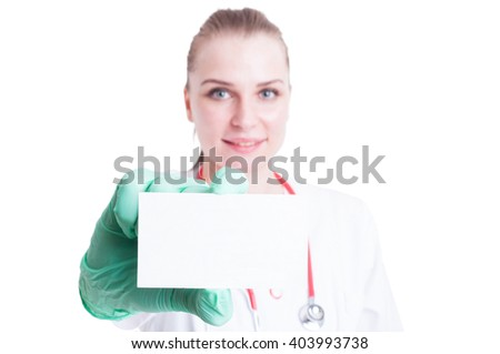 Close-up of business or visit card in female doctor hand with copy space or advertising area isolated on white