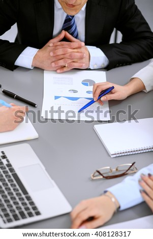 Close up of business people at meeting