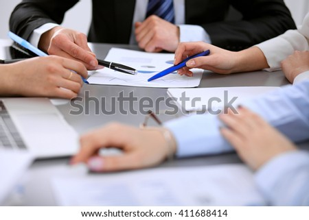 Close up of business people at meeting - stock photo