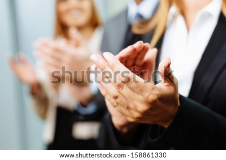 Close-up of business people clapping hands. Business seminar concept - stock photo